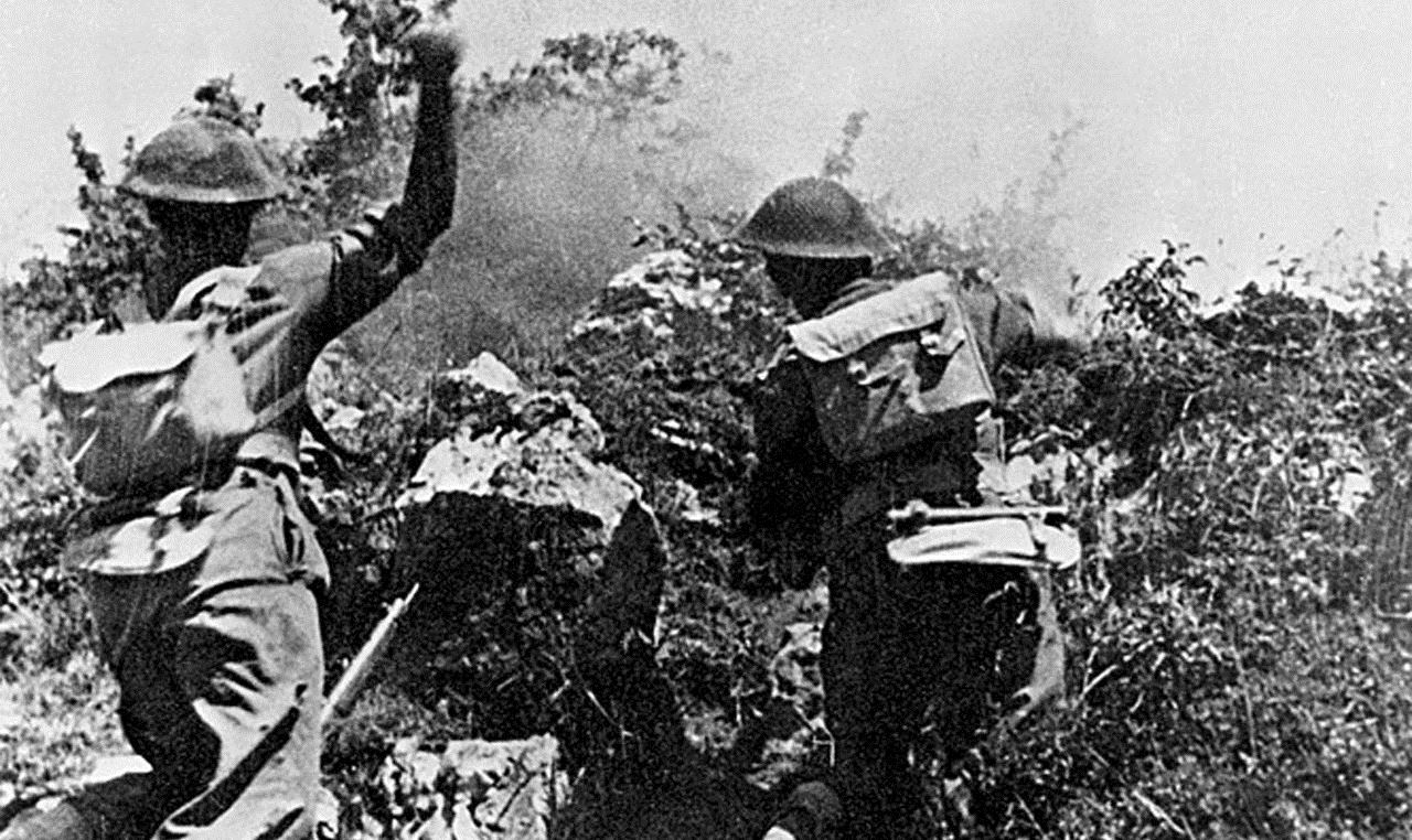 Troops of the 2nd Polish Corps throwing grenades at the enemy during heavy fighting around Monte Cassino.