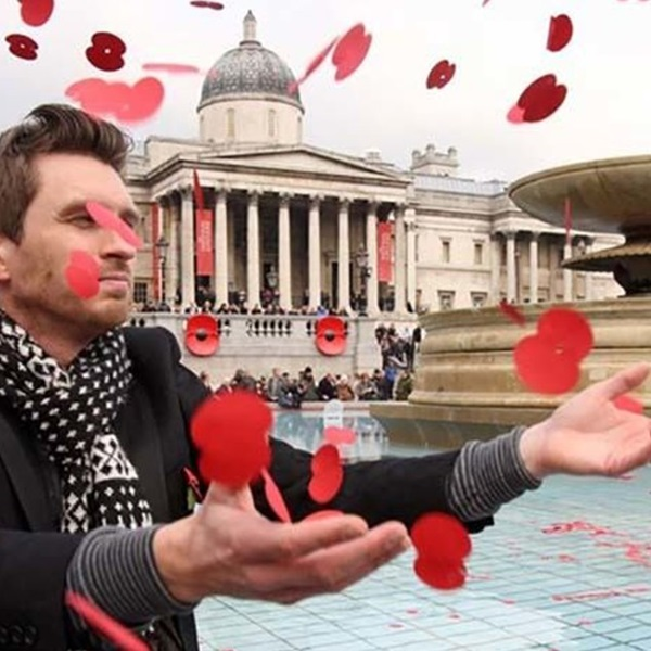 Man catching poppies at Silence in the Square in Trafalgar Square
