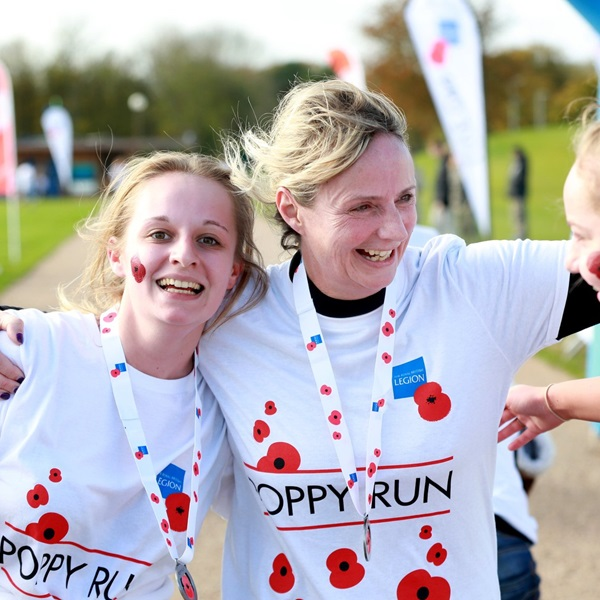 Poppy Run runners from Military Kids Club wearing medals