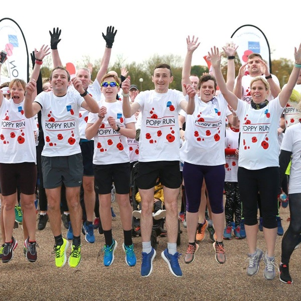 Poppy Run team from Nottingham jumping in the air