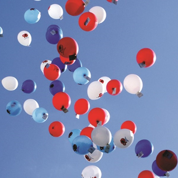Balloons floating up in the sky to encourage people to leave a legacy to the Legion